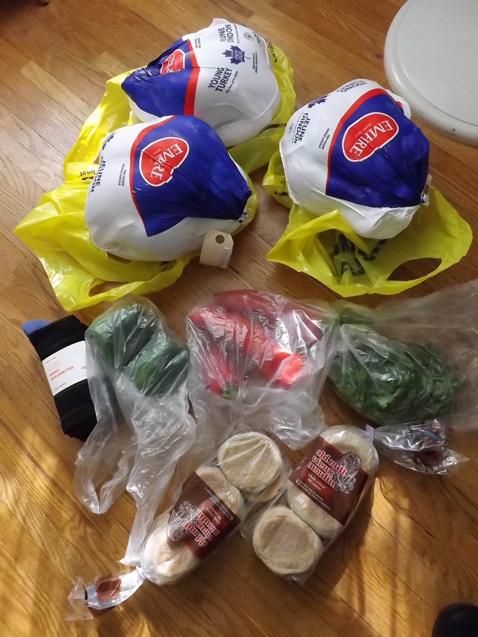groceries with total cost of 95 cents, includes 3 frozen turkeys, socks, green peppers, red peppers cilantro and two packages of English Muffins.