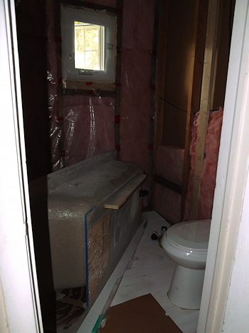 DSCF3260 bathroom floor primer tub