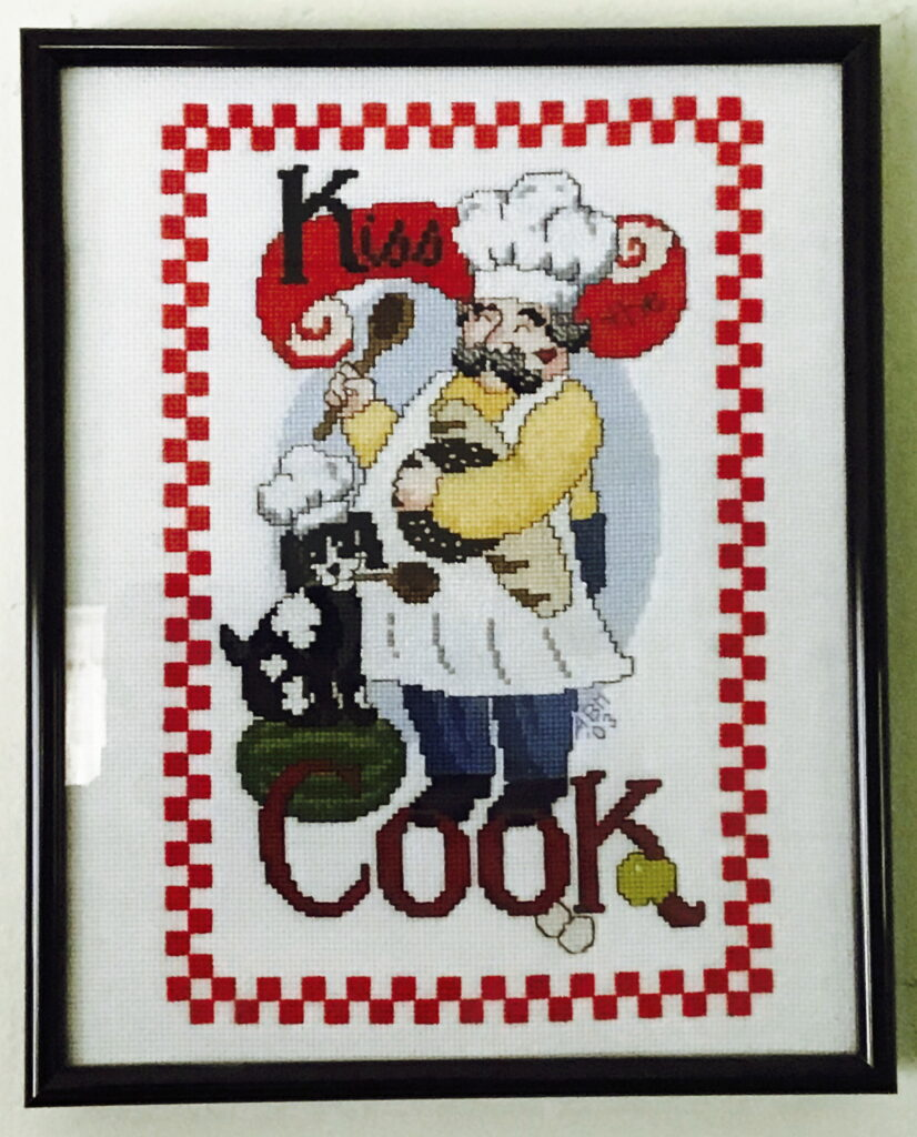 kisss the cook image, chef and dog with chef hats and wooden spoons
