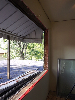 hole in the wall of the dining room after the large window was removed